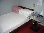 獅城大旅館ベッド
